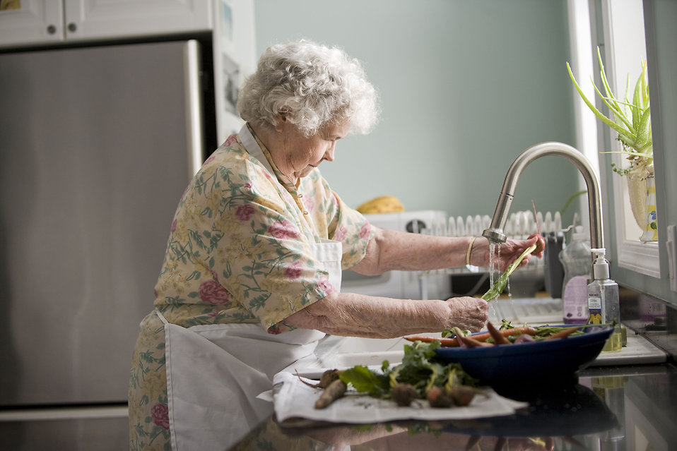 17513-an-elderly-woman-washing-produce-pv